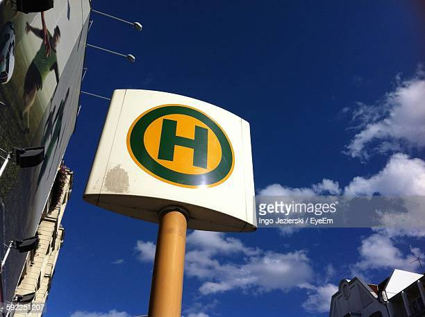 Low Angle View Of Hospital Sign Against Sky