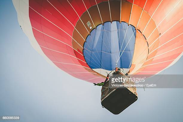 low angle view of hot air balloon against clear sky - balloon ride stock pictures, royalty-free photos & images