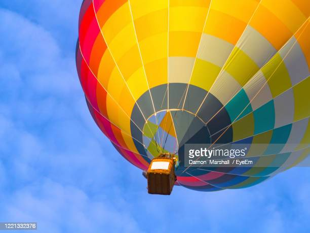 low angle view of hot air balloon against sky - hamilton new zealand stock pictures, royalty-free photos & images