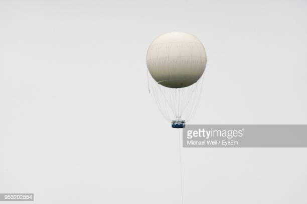 low angle view of hot air balloon against sky - balloon fiesta stock pictures, royalty-free photos & images