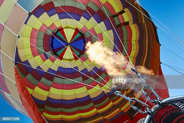 Low angle view of hot air balloon and blue sky, Cappadocia, Anatolia, Turkey