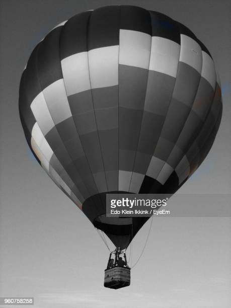 low angle view of hot air balloon flying against sky - klein stock pictures, royalty-free photos & images