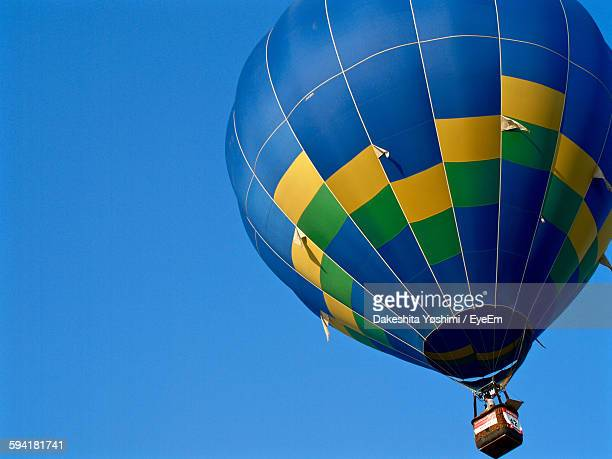 low angle view of hot air balloon in clear blue sky - 佐賀県 ストックフォトと画像