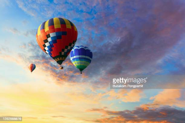 low angle view of hot air balloons against blue sky - moving up stock pictures, royalty-free photos & images