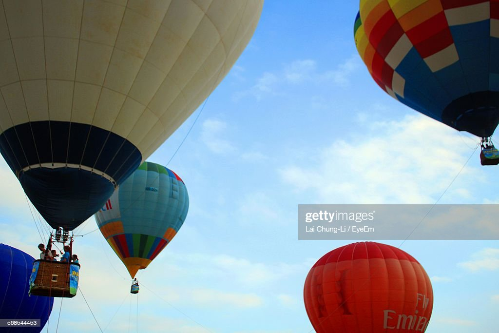 Low Angle View Of Hot Air Balloons In Sky : Stock Photo