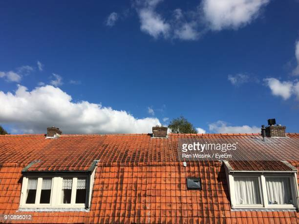 low angle view of house roof against sky - zwolle stock pictures, royalty-free photos & images