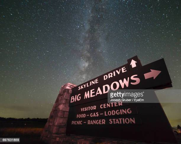 low angle view of huge signboard on field against galaxy - shenandoah_national_park stock pictures, royalty-free photos & images