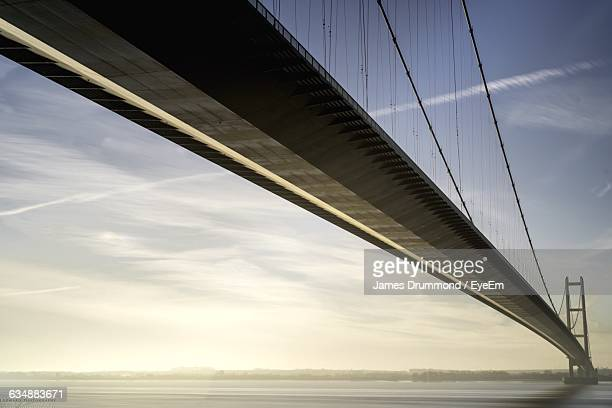 Low Angle View Of Humber Bridge Over River At Sunset