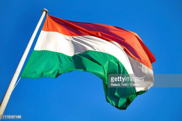 low angle view of hungarian flag against clear blue sky - hungary stockfoto's en -beelden