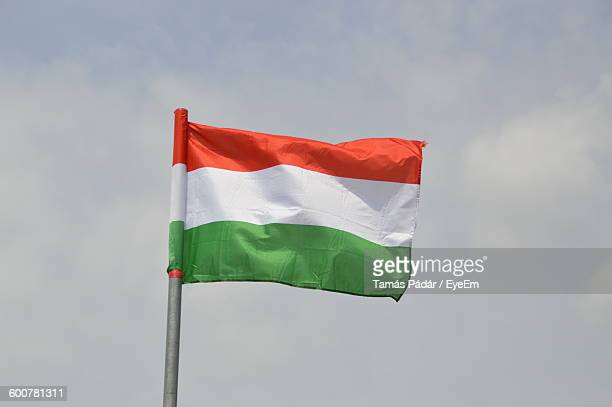 Low Angle View Of Hungarian Flag Against Sky