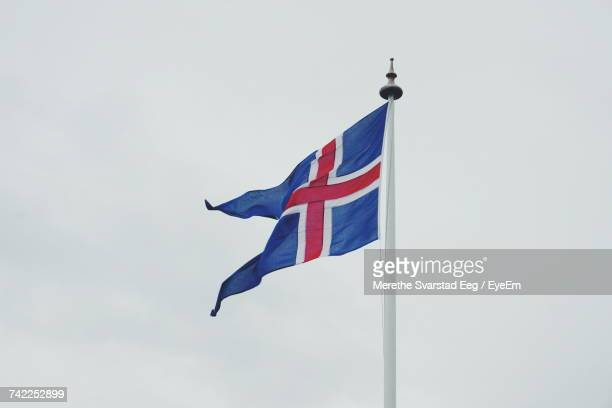 Low Angle View Of Icelandic Flag Against Clear Sky