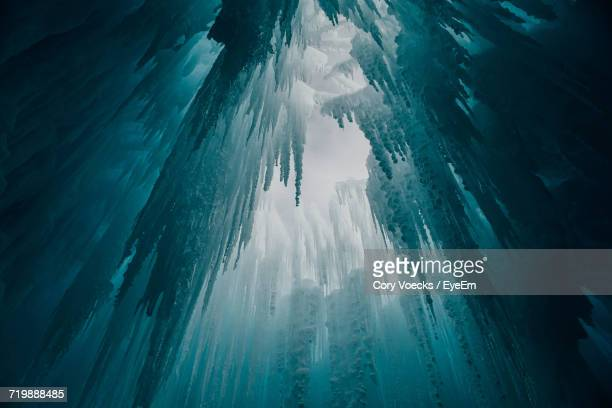 Low Angle View Of Icicles In Cave