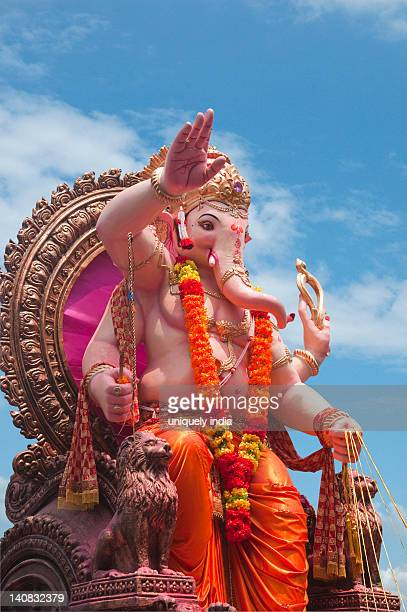Low angle view of idol of Lord Ganesha, Mumbai, Maharashtra, India