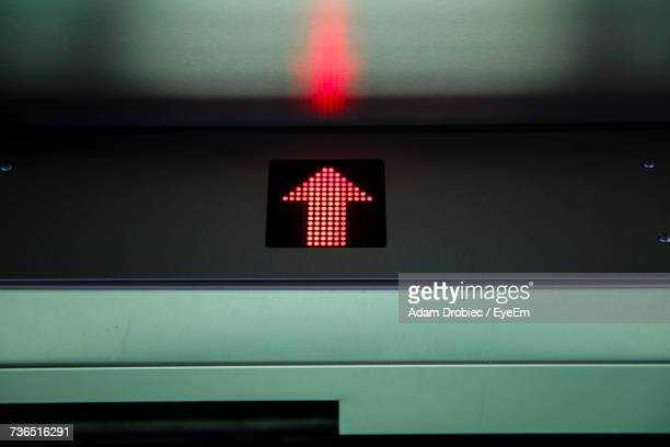 Low Angle View Of Illuminated Arrow Symbol In Elevator