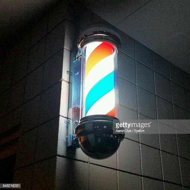 Low Angle View Of Illuminated Barbers Pole
