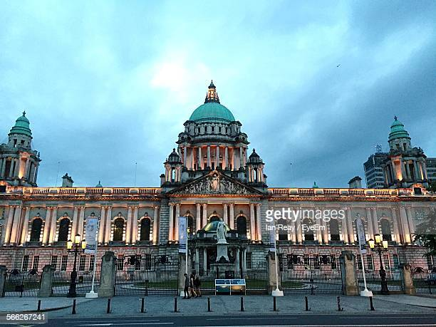 low angle view of illuminated belfast city hall against sky - belfast stock pictures, royalty-free photos & images