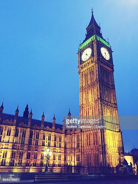Low Angle View Of Illuminated Big Ben Against Clear Sky
