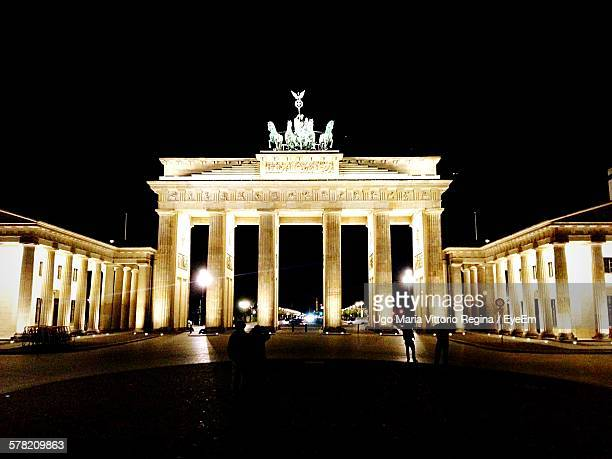Low Angle View Of Illuminated Brandenburg Gate Against Clear Sky At Night
