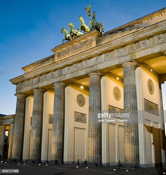 Low Angle View Of Illuminated Brandenburg Gate Against Clear Sky At Dusk