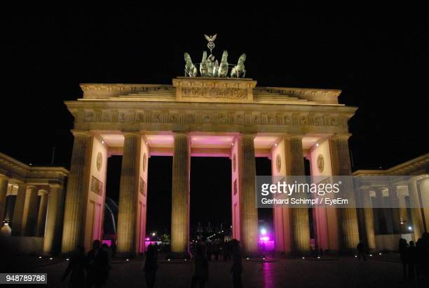 low angle view of illuminated brandenburg gate against clear sky at night - gerhard schimpf stock photos and pictures