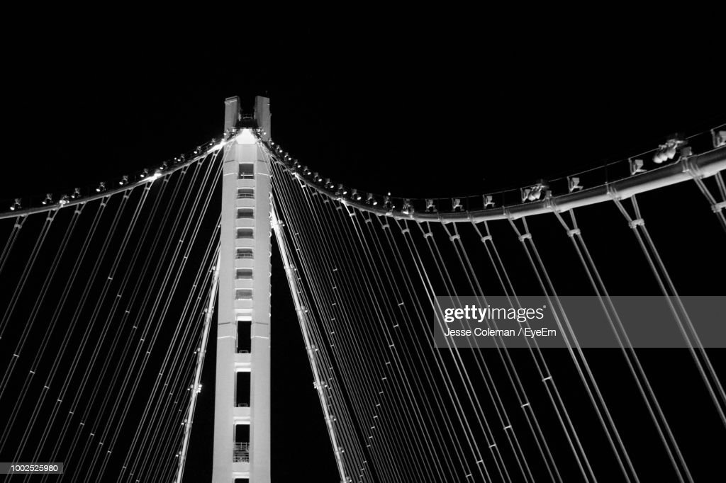 Low Angle View Of Illuminated Bridge Against Sky At Night : Stock Photo