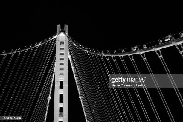 low angle view of illuminated bridge against sky at night - jesse coleman imagens e fotografias de stock