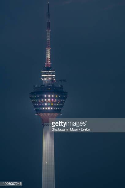 low angle view of illuminated building against clear sky - shaifulzamri stockfoto's en -beelden