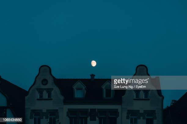 low angle view of illuminated building against sky at night - erfurt stock pictures, royalty-free photos & images