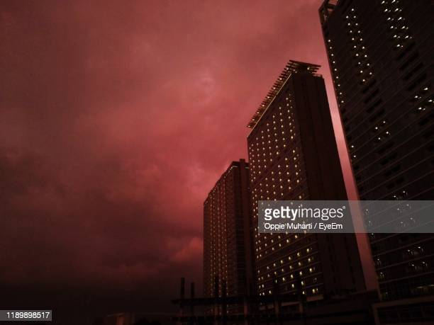low angle view of illuminated building against sky at night - oppie muharti stock pictures, royalty-free photos & images