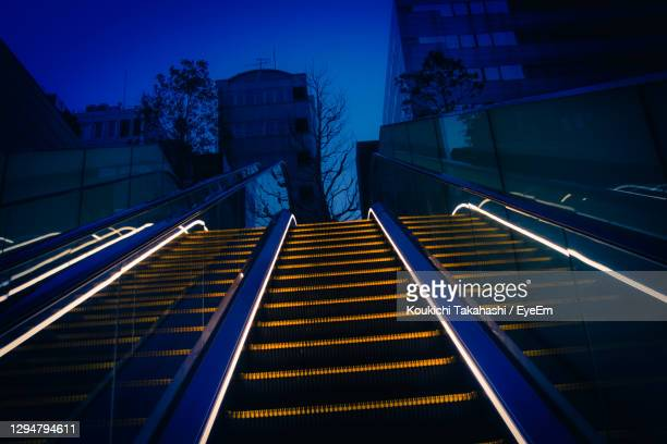 low angle view of illuminated building at night - koukichi stock pictures, royalty-free photos & images