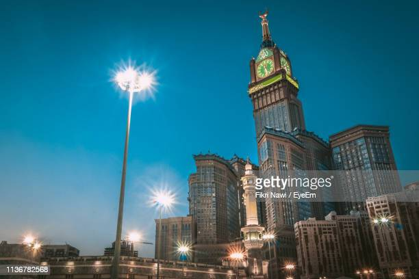 low angle view of illuminated buildings at night - clock tower stock pictures, royalty-free photos & images