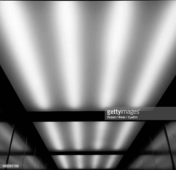 Low Angle View Of Illuminated Ceiling On Elevator