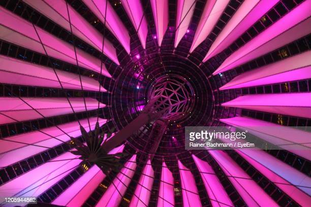 low angle view of illuminated ceiling - sony center berlin stock pictures, royalty-free photos & images