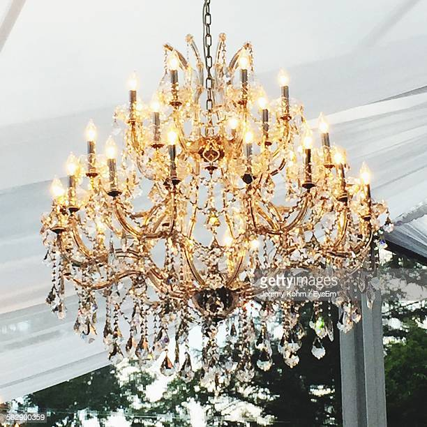 Low Angle View Of Illuminated Chandelier In Tent