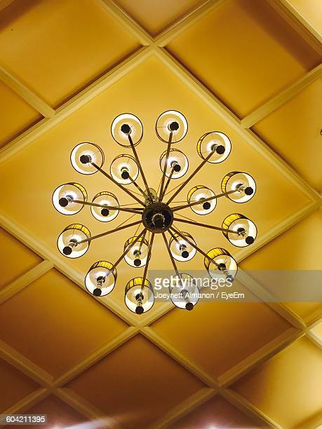 Low Angle View Of Illuminated Chandelier On Ceiling