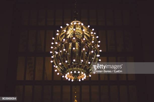 low angle view of illuminated chandelier on ceiling - bortes foto e immagini stock