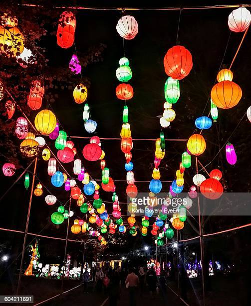 Low Angle View Of Illuminated Chinese Lanterns Hanging At Night