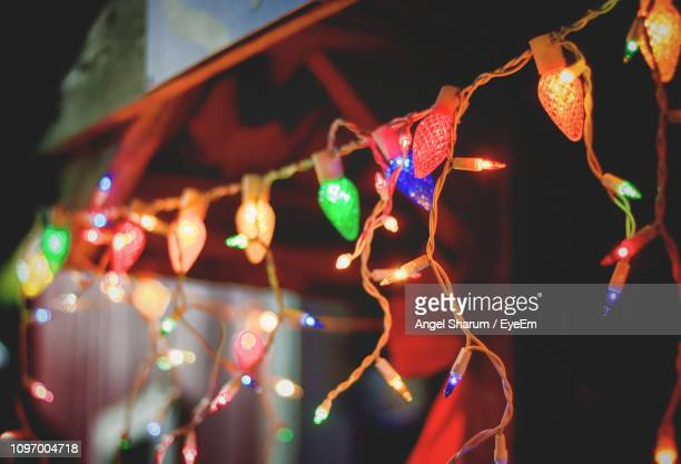 low angle view of illuminated christmas light at night - christmas lights stock pictures, royalty-free photos & images