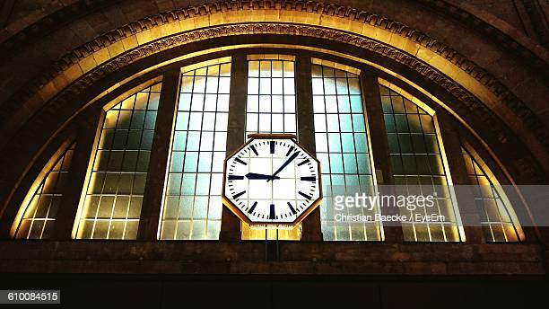 Low Angle View Of Illuminated Clock At Leipzig Hauptbahnhof