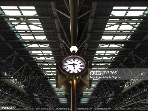 Low Angle View Of Illuminated Clock On Ceiling On Railroad Station