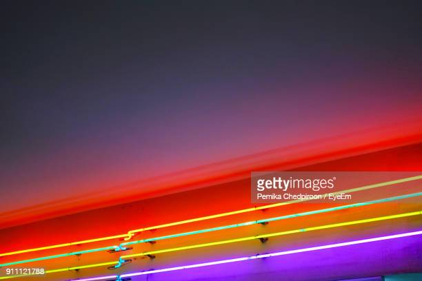 Low Angle View Of Illuminated Colorful Lights At Night
