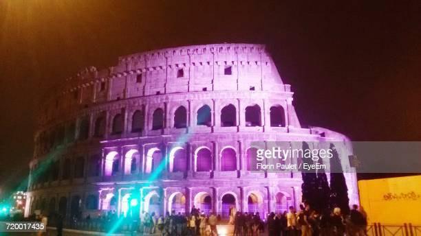 Low Angle View Of Illuminated Colosseum At Night