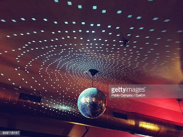 Low Angle View Of Illuminated Disco Ball Hanging To Ceiling