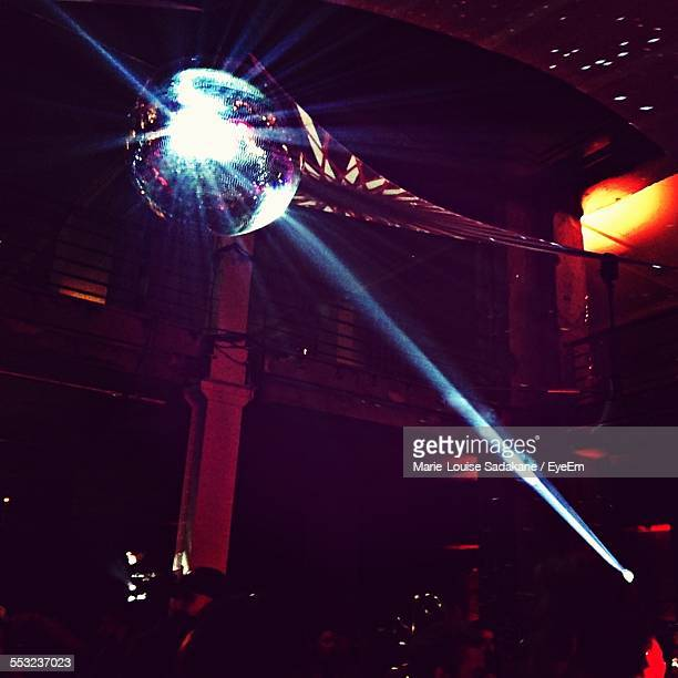 Low Angle View Of Illuminated Disco Ball In Nightclub