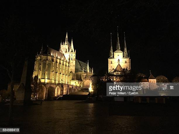 low angle view of illuminated erfurt cathedral at town square at night - erfurt stock pictures, royalty-free photos & images