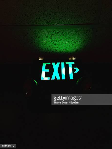Low Angle View Of Illuminated Exit Sign