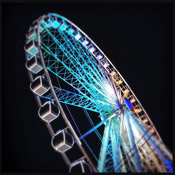 Low Angle View Of Illuminated Ferris Wheel Against Clear Sky At Night Wall Art