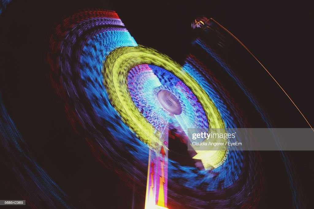 Low Angle View Of Illuminated Ferris Wheel Against Sky At Night : Stock Photo