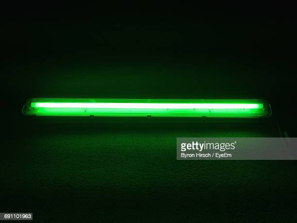 Low Angle View Of Illuminated Fluorescent Light On Wall