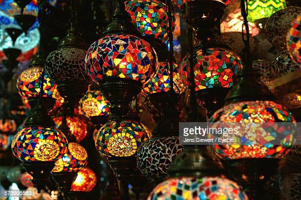 low angle view of illuminated hanging lights - jens siewert stock-fotos und bilder